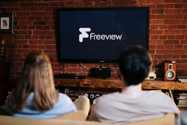 couple watching freeview tv